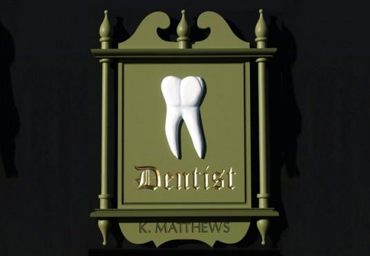 K. Matthews Dentist Sign