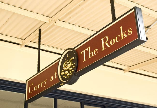 Curry at the rocks restaurant sign danthonia designs au