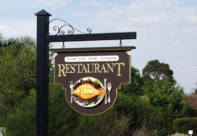 Top of the town restaurant sign danthonia designs au