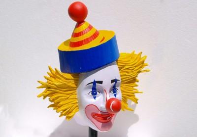 Clown Head Sculpture Business Sign