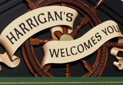 Harrigans_Drift_Inn_sculpted_banner_&_ships_wheel