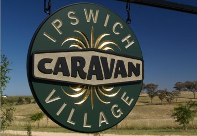 Ipswich Caravan Village round entry logo sign