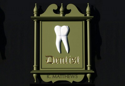 K. Matthews Dentist Sign