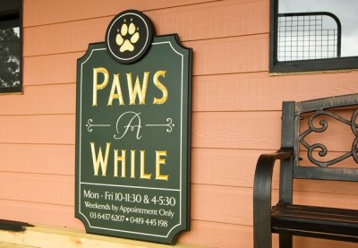 Paws A While Business Sign