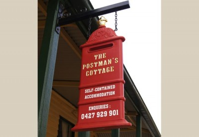 Postman's Cottage Hanging sign