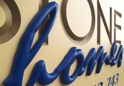 Stone Homes Business Sign