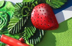 3d-sculpted-strawberry-and-peppers-on-business-sign