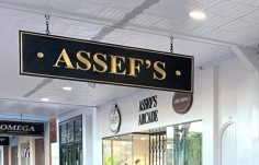 suspended-awning-business-sign-with-gilding