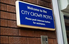 City Crown Motel Door Sign