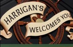 Harrigans_Drift_Inn_sculpted_banner_&_ships_wheel