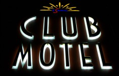 Inverell Club Motel sign at night