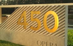 custom-sign-concrete-plinth-brass-letters