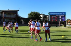 players-warming-up-in-front-of-electronic-scoreboard-at-port-hedland-wa