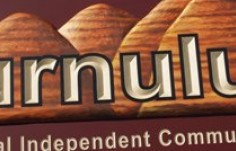 punululu-aboriginal-school-sculpted-and-artist-painted-signage